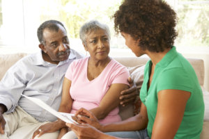 senior couple talking to home care agent