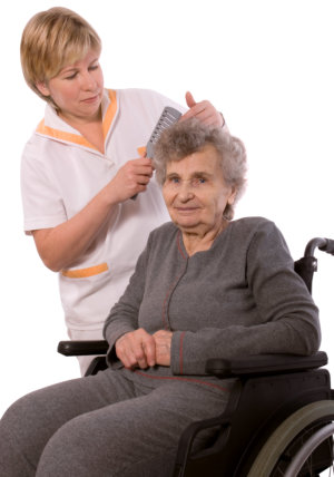nurse grooming a senior woman's hair